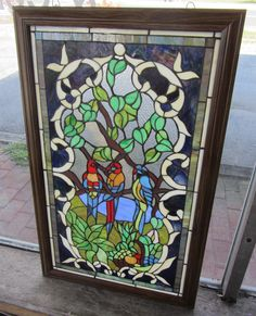 20th C. Stained glass window with parrotts 37 1/2  x 23 Auction Estimate 200-400