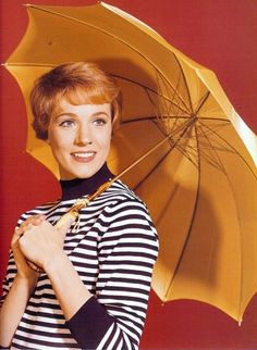 julie andrews; great shirt but I'd skip the umbrella, -- although it goes well with her hair :)