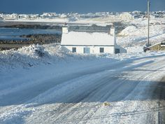 Cottage in snow Anglesey.