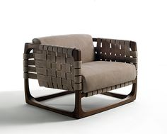 Occasional Chair 06085 with structure in solid walnut, oak, maple or cherry wood. Arms and back in woven leather, seat and seat back in leather.