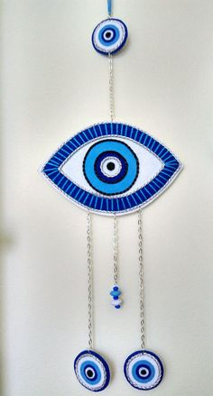 Evil Eye protection symbol - wall decor for home ( the personal collection of Cristiana Neamțu) Protection Symbols, Eye Protection, Clay Crafts, Felt Crafts, Evil Eye Art, Hamsa Art, Crochet Rings, Crochet Eyes, Turkish Art