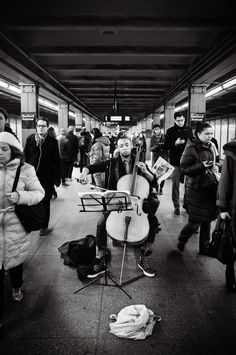 Rush Hour Cello; photograph by Will O'Hare. New York City