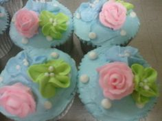 Pale Blue Buttercream Iced Cupcakes with Pink Petite Roses, Lime and Perriwinkle Flowers and White Pearls