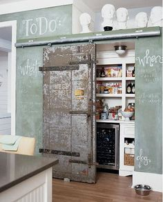 Pantry behind a salvaged door on sliders- very cool!