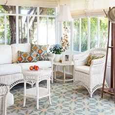 Full of character, this breezy sunroom features reclaimed tile from France, spruced-up rattan hand-me-downs, and a weathered chandelier found on eBay.