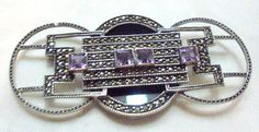 Beautiful pin in the art deco style by Judith Jack. 3 Circles with marcasite, black onyx and amethyst. Wonderful condition. 3 1/4 by 1 1/2 inches. Stunning pin.   Thank you... #amethyst #vtpass #vrev #teamlove #vogueteam #bitzofglitz4u