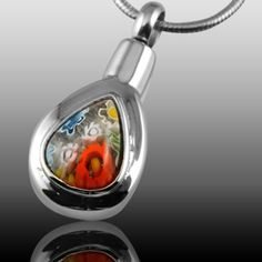 The Colorful Flowers Cremation Pendant is made of stainless steel and created by artist jewelers. The quality is incomparable and the craftsmanship outstanding. This Keepsake Pendant can hold a small amount of the cremation ashes or a piece of hair to memorialize your loved one forever. You can keep your loved one close to your heart at all times.