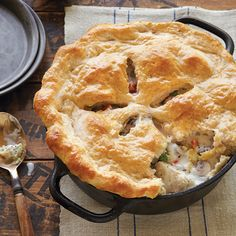 New England Chicken Potpie with Biscuit Crust Recipe - Country Living - This surprisingly easy to make version of all-American chicken potpie comes from cookbook author Jim Villas, and uses farm-fresh peas, onions, mushrooms, celery, and carrots for the filling.
