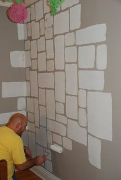 a castel stone wall., Painting the stones onto the wall with a sponge and a roller., Bedrooms Design