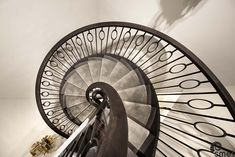 Solid French Oak open treads and a bespoke spindle design on these contemporary winding stairs.