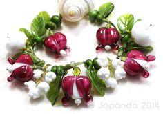 JOPANDA lampwork Beads handmade SRA - Bleeding-Hearts & Lily of the valley, sold for $143.50 on eBay.