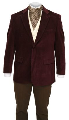 Delight in the impeccable style of our burgundy velvet smoking jacket, with rich trim throughout.    While today the smoking jacket is an elegant alternative to a formal tuxedo, in the Victorian era this garment served a much more specific purpose in at-home entertainment. Scrupulously dressed 19th century gentlemen (who literally had a coat for every occasion) would don a soft, often velvet, loose jacket over their clothing as a protective barrier from the odors of their smoking…