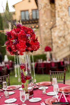 Our beautiful table decor! #tablesetting #redtabledesign #redroses #crystals #redwedding #weddingplanner  http://www.wedinthecity.com