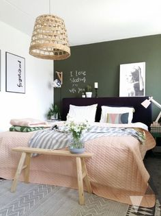 Scandinavian style bedroom with dark green wall. We examine the three key ways to go green with the new interior design trend for dark green walls. From Scandinavian style to gold and copper accents, to emerald green and monochrome.