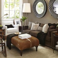 Benjamin Moore Brandon Beige 977 on walls. Love the ottoman and white/brown furniture. Living room