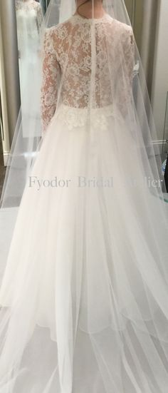 Fyodor Bridal Atelier stunning bridal dress. French lace, silk, sheer back.
