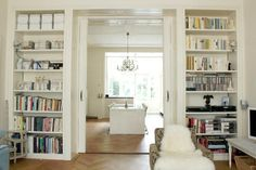 Pocket door bookcase room divider to separate the master bedroom and closet/dressing room