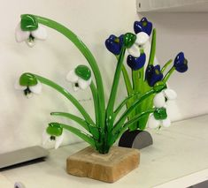 Desk ornament of flower bunch growing from wood base