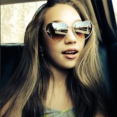 Hey, this is Maddie Ziegler, She's 12 years old and she does dance on the show dance moms. SHE IS MY ROLE MODEL!!!!