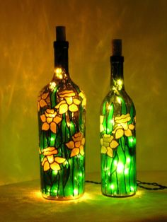 Daffodils stained glass bottle with lights-I bet you could make your own version of stained glass bottles with tissue paper cut-outs and some glue. Glass Bottle Crafts, Wine Bottle Art, Painted Wine Bottles, Glass Bottles, Empty Bottles, Decorated Bottles, Vodka Bottle, Perfume Bottles, Bottle Bottle