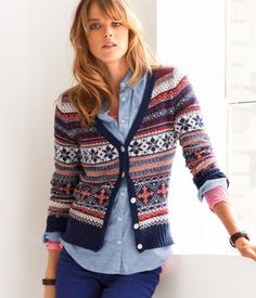 €29.95 Jacquard-knit cardigan with buttons at the front. 5% angora, 20% polyamide, 25% viscose, 50% cotton. Machine wash at 30˚