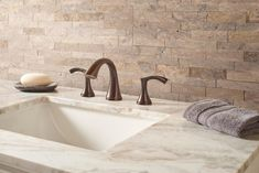 Upgrade your bathroom with a natural stone backsplash! Our Landscape 4.5x16 Natural Stone Ledger Panel in Roman Beige Petite features striking and dynamic stones that instantly upgrades your bathroom! Starting at $10.99 SQ FT these panels can be installed in the interior or exterior of the home.