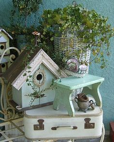 Shabby vignette.  Love the use of the picture frame on the roof of the bird house!