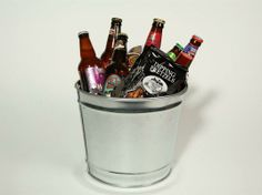 Microbrew Beer Bucket- Packed snugly into a sleek galvanized-steel bucket, these microbrews and gourmet snacks from Gourmet Gift Baskets ($70) make for an instant game-day party. Six popular microbrews, including Magic Hat #9, Smuttynose Old Brown Dog Ale, and Harpoon Munich Dark, are paired with mixed nuts, pretzels, and meaty, tender beef jerky. Bonus points for the inclusion of a bottle opener.