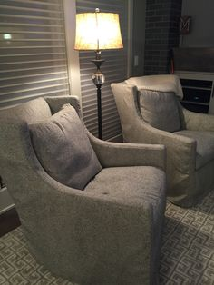 Elegant Swivel Glider Chairs By LEE Industries In Kitty Grey