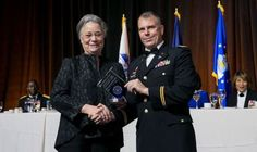 Army Lt. Col. Kurt Schaecher, chief of the Infectious Disease laboratory at Walter Reed National Military Medical Center in Bethesda, Maryland, receives the Healthcare Excellence in Patient Safety award from Dr. Karen Guice (left), principal deputy assistant secretary of Defense for Health Affairs, performing the duties of the assistant secretary of Defense for Health Affairs, at the AMSUS (the Society of Federal Health Professionals) meeting, Dec. 1, 2016, at National Harbor near…