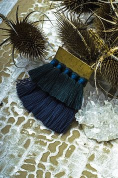 "The York Pendant echoes the colors of the forest as summer days fade into night. The lower layer of slate grey tassels swing with movement, making this pendant extra fun to wear. * 23"" Long Antique Br"