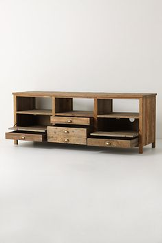 anthropologie media cabinet - great way to marry rustic with tech needs