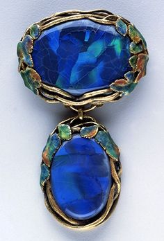 An Arts and Crafts gold, black opal and enamel brooch/pendant by Louis Comfort Tiffany for Tiffany & Co., 1918.