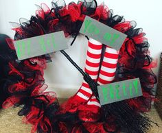 Deco mesh Wizard of Oz wreath. Socks stuffed with newspaper and rolled magazines. Wood boards from Hobby Lobby painted grey then stamped with lime green paint. Ruby slippers a cheap buy from Walmart. Broom from Hobby Lobby. Deco mesh cut in 6in pieces, 4 pieces pinched into bows and attached with black pipe cleaners.