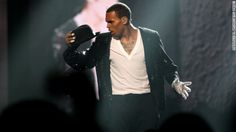 """Singer Chris Brown totals car while being """"ruthlessly pursued by paparazzi,"""" his representative said. (via CNN)"""