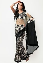 Black coloured saree for women by Mahotsav. This embellished saree is made from net and comes with unstitched blouse piece.
