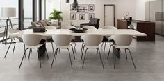 Qstone - Endless - Keramische tegels in betonlook Stone Tiles, Concrete, Conference Room, Dining Table, Fan, Interior, Furniture, Home Decor, Indoor