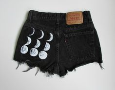 What better way to get in touch with your inner moon child than to wear the Moon Phases on your derriere. Hand painted on upcycled black denim with distressed detailing on front. Since each pair is hand painted the product will vary slightly from the one pictured. Your shorts will ship about one week after order is placed. Each pair is made by hand and takes lots of love and time.