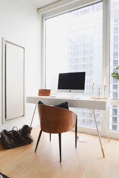 Noa Santos Manhattan Apartment: A midcentury deskpaired with a vintage barrel chairin the bedroom makes for a discreet home workstation.