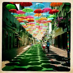 You ever see Hundreds of Floating Umbrellas Above A Street? If you travel to Agueda in Portugal during July you will see it with colorful umbrellas floating above some streets. Umbrella Street, Umbrella Art, Places To Travel, Places To See, Travel Destinations, Colorful Umbrellas, Sidewalk Art, Public Art, Public Spaces