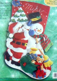 Kit #83974 - from 1999. This is a very cute Bucilla felt stocking kit. The stocking shows Santa and Frosty out for a day in the snow. In front of them is a sack full of toys and gifts.