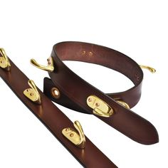 Five solid brass hooks riveted into a thin strip of rugged buffalo hide, our barrack strap is a necessity on any safari or camp site. Hang it on a nail and you instantly have a place to stow your jacket, hat, camera, or binoculars. No nail handy? Wrap a cord around a tree and suspend it. Roll it up and tuck it in your ruck sack when you're headed home. Ideal for your house or garage, too. So incredibly convenient you'll find a hundred uses for it! A neat unique gift for a camper they'll find…
