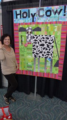 Melanie McFarland and her Holy Cow quilt...  :)