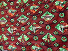 Zambian fancy wax c. 1970 - This is a Zambian fancy wax (single sided) roller print in four colors, with the distinctive red and orange (referenceing copper) that so often appears in Zambian national iconography.  There is no selvege mark, but there is a distinct fake crinkle pattern applied at the edges, referencing a West African style wax print pagne.