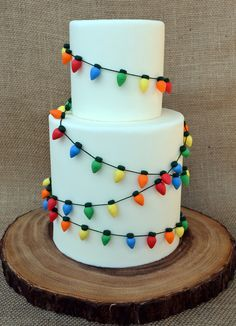String up the lights on your cake too! Sugar lights, that is. Created by Adorn Cake Design. String up the lights on your cake too! Sugar lights, that is. Created by Adorn Cake Design. Christmas Cake Designs, Christmas Cake Decorations, Christmas Sweets, Holiday Cakes, Christmas Baking, Christmas Cakes, Christmas Lights, Elegant Christmas, Xmas Cakes
