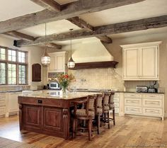 #Kitchen of the Week: An antique white kitchen with rustic beams and a cherry island. Rustic Kitchen Design #27 (Kitchen-Design-Ideas.org)