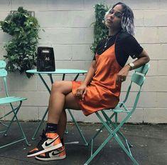 orange silk slip layered over a black t-shirt paired with black and orange sneakers. Visit Daily Dress Me at dailydressm Fashion Killa, Look Fashion, 90s Fashion, Fashion Outfits, School Fashion, Fashion 2018, Fall Fashion, Hippy Fashion, Urban Fashion Women