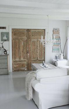 white / pastel / wooden doors / living room /