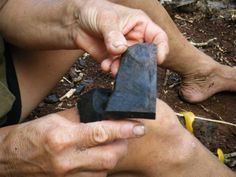 Brenda Christian holds one of the many pieces of rock left in piles from many years ago. Pitcairn Islands, Christian, Rock, Skirt, Locks, The Rock, Rock Music, Christians, Batu