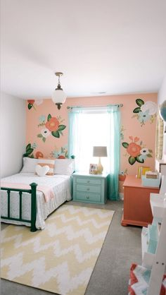 I *love* this wallpaper! This is really a unique little girl's room.